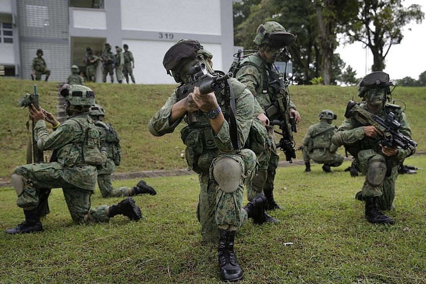 Soldiers preparing for a drill during a military exercise last month. The last time NS allowances were raised was in 2012, when they went up by $60.