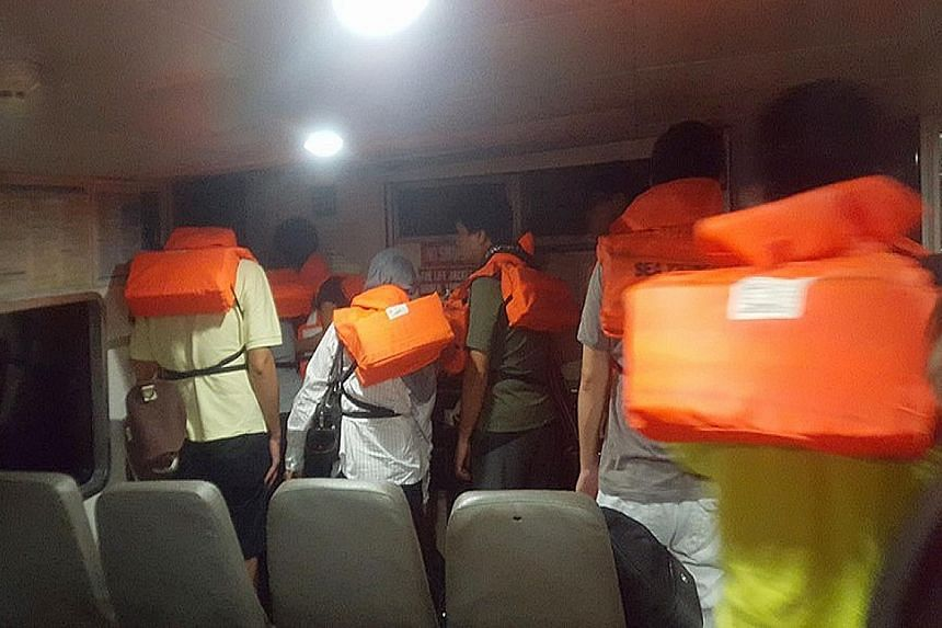 The passengers put on life vests and got off the ferry and onto life rafts after it was hit by a floating object.