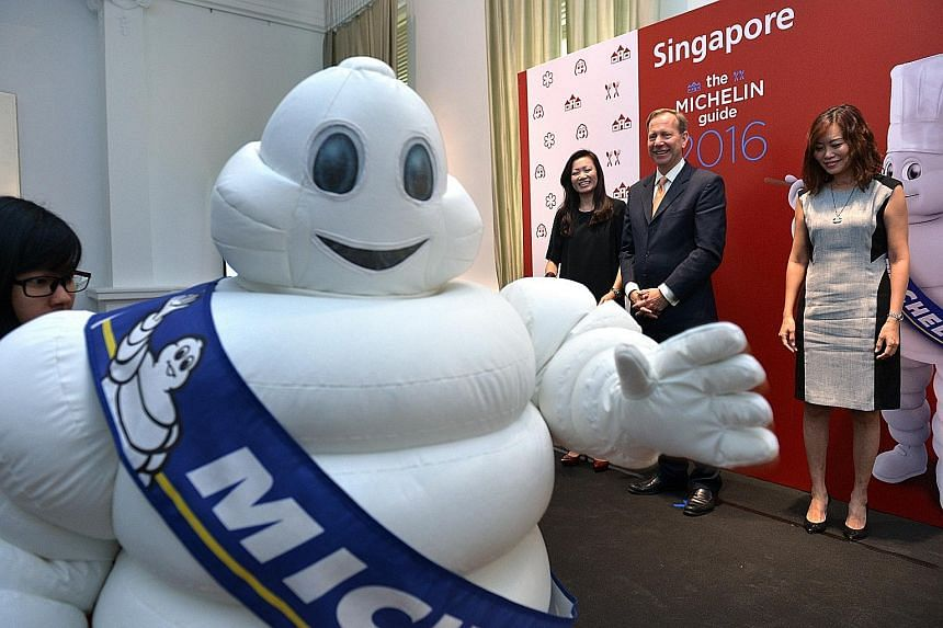 Announcing the launch of Michelin Guide's bilingual Singapore edition next year are (from left) Ms Melissa Ow, deputy chief executive of the Singapore Tourism Board; Mr Michael Ellis of Michelin Guides International; and Ms Michelle Ling, director of