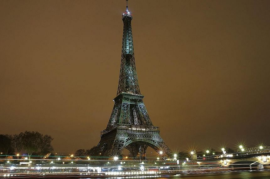 The Eiffel Tower lighting up with colours and messages of hope on the eve of the climate conference in Paris.
