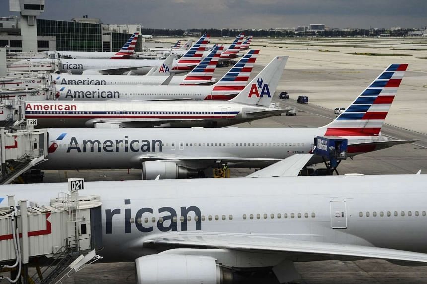 American Airlines planes are seen on the tarmac at Miami International Airport in Miami, Florida.