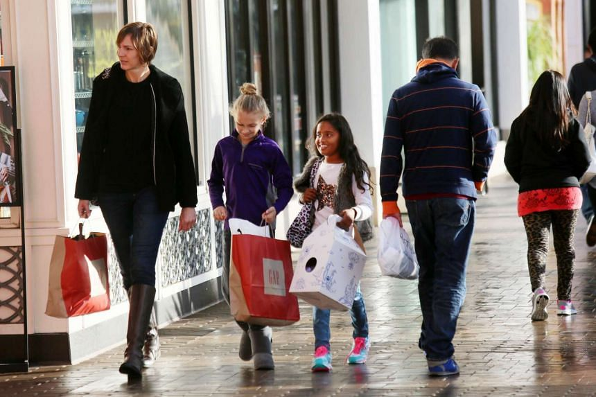 Holiday shoppers at a mall in San Diego, California, on Nov 27.