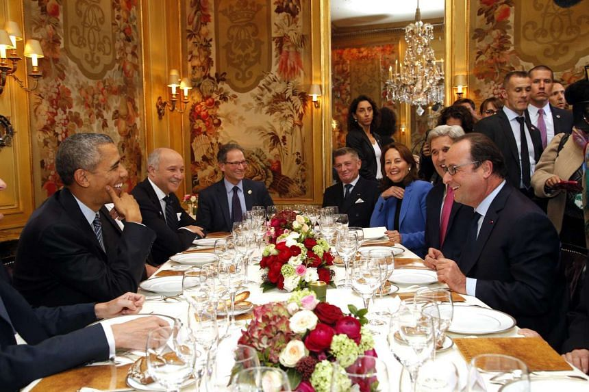 US President Barack Obama (left) and his French counterpart Francois Hollande (right) having dinner at the Ambroisie restaurant in Paris, France.