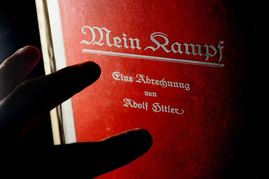 A signed copy of a first edition of Adolf Hitler's book Mein Kampf.