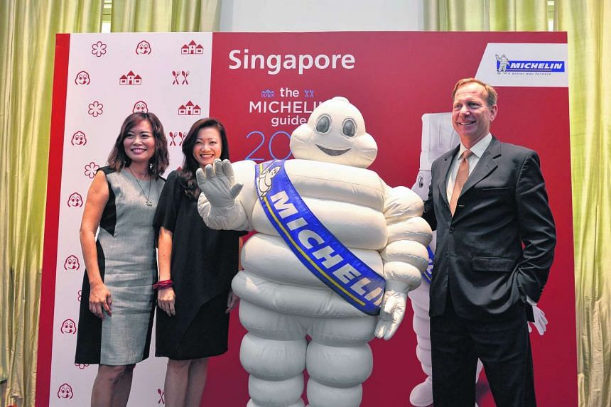 The Michelin mascot posing for a photo with (from left to right) Ms Michelle Ling, Director of Robert Parker Wine Advocate, Ms Melissa Ow, deputy chief executive of STB and Mr Michael Ellis of Michelin Guides International.