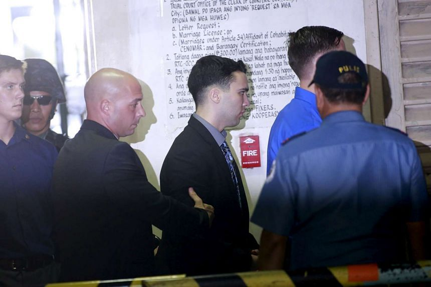 US Marine Lance Corporal Joseph Scott Pemberton is escorted by security officers to a court in Olongapo City.