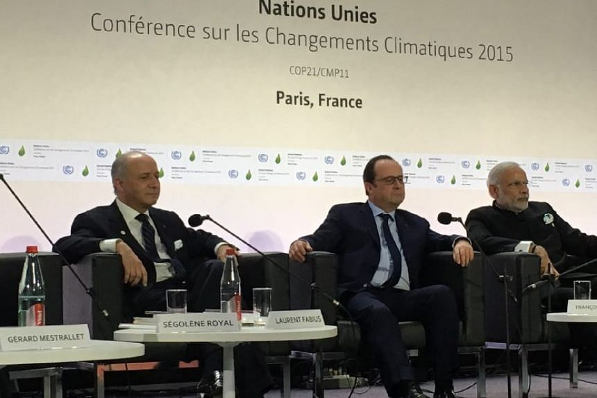 (From left to right) France's Foreign Minister Laurent Fabius, French President Francois Hollande and India's Prime Minister Narendra Modi launching the International Solar Alliance on Monday in Paris.