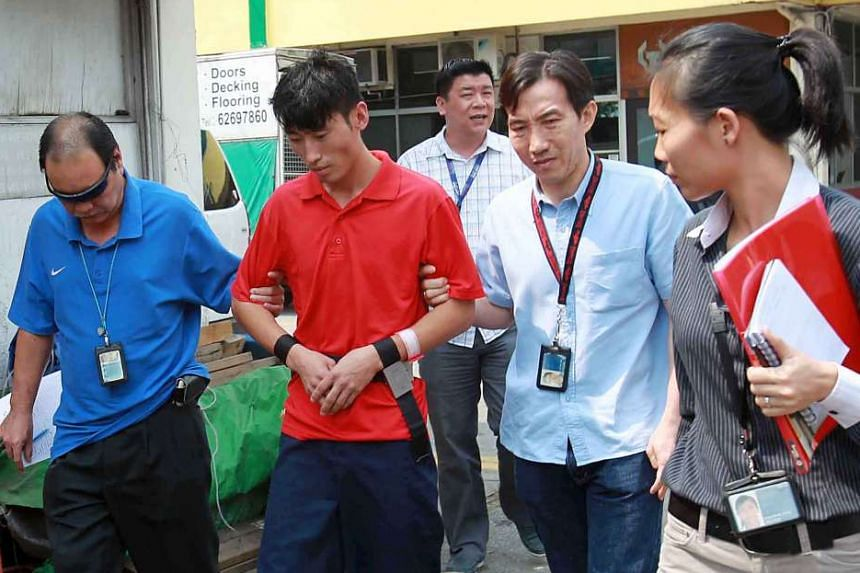 Chinese national Li Yongxiang revisiting the crime scene on June 24, 2013. Li had originally been charged with murder, but a government psychiatrist found that he had a major depressive episode at the time, reducing his mental responsibility for his acts.