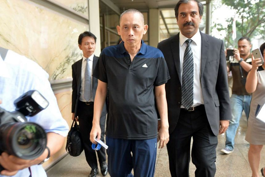 Dan Tan leaving the Supreme Court building with his lawyers on Nov 25 2015.