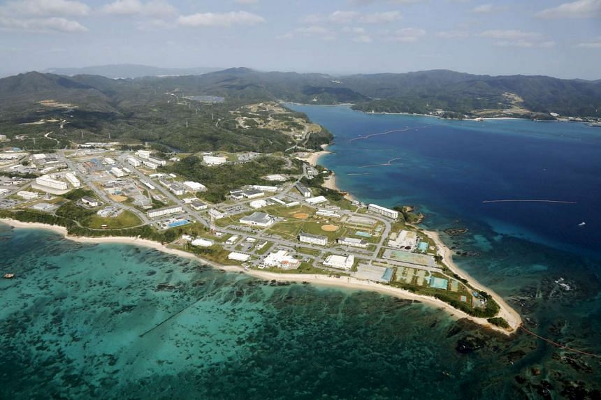 A dispute between Japan's government and the southern island of Okinawa went to court as locals opposed the building of a new US military base there.