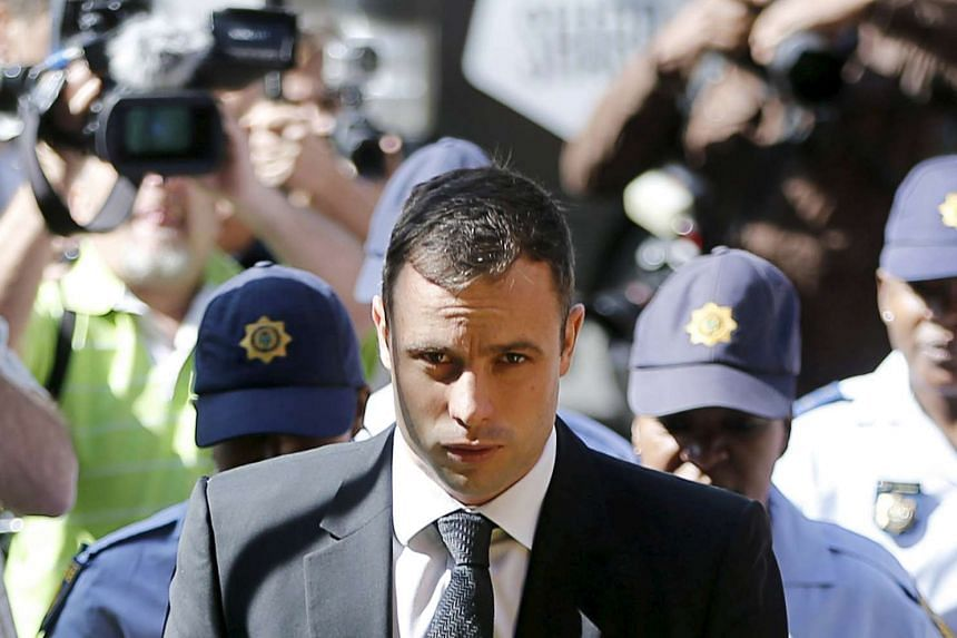South African Olympic and Paralympic sprinter Oscar Pistorius leaves the North Gauteng High Court in Pretoria on Oct 17, 2014.