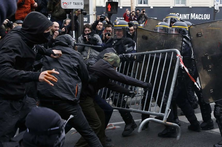 Protesters clashing with riot police during a rally on Nov 29, 2015 in Paris.