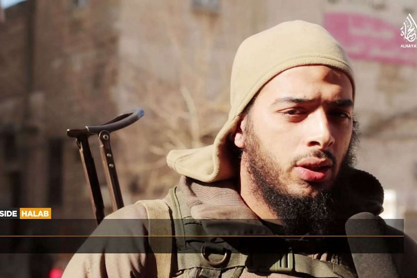 """A file image grab taken from a video uploaded in Feb 2015 by Al-Hayat Media Centre allegedly shows French jihadist Salim Benghalem speaking in a TV report from Aleppo, titled """"Inside Halab""""."""