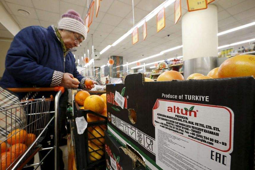 Grapefruit, imported from Turkey according to labels and product information on the box, are on sale at a grocery of the food retailer Dixy in Moscow, Russia, on Dec 1, 2015.