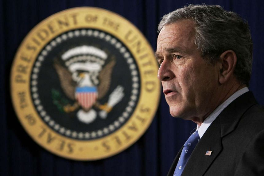 A file photo of then US President George W. Bush during a speech in Washington, DC on Dec 20, 2006.