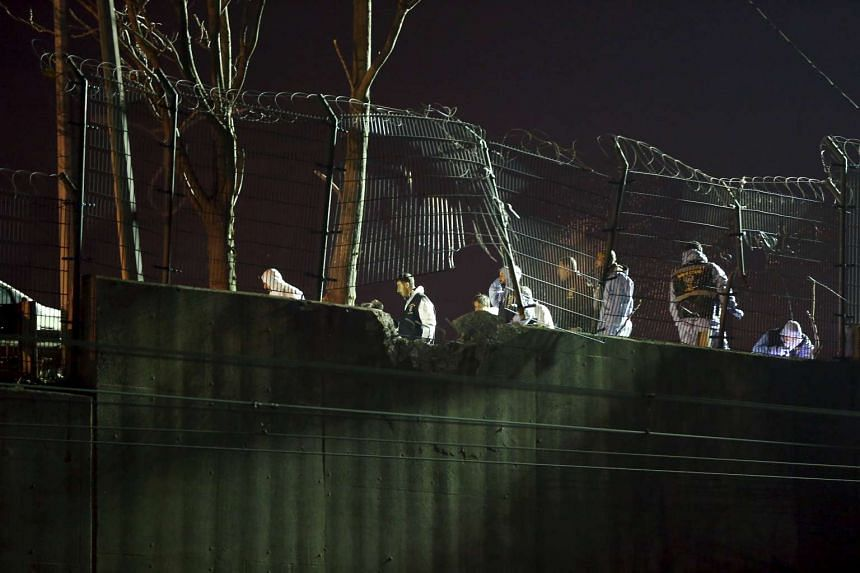 Forensic officers work on the blast scene in Istanbul, Turkey, December 1, 2015. Five people were injured when a pipe bomb exploded on an overpass near an Istanbul metro station on Dec 1, 2015.