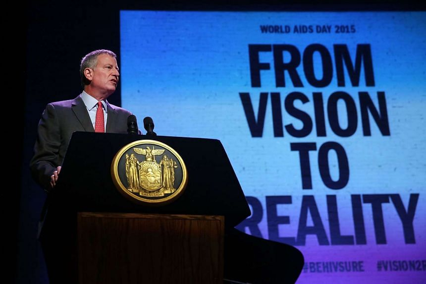 New York Mayor Bill de Blasio addresses a World AIDS Day gathering in Harlem on Dec 1, 2015 in New York City. The event, at the historic Apollo Theater, brought together over 60 AIDS-service and community-based organizations and the NYC Department Of