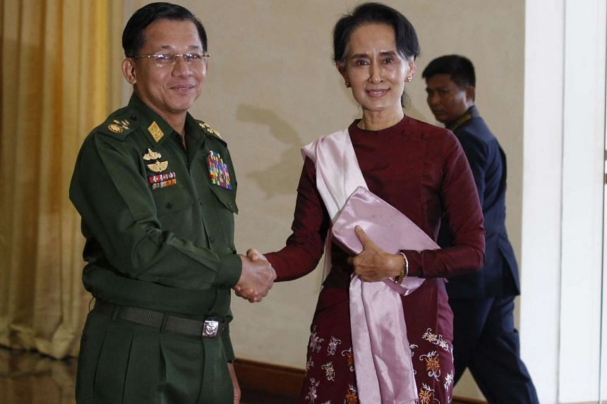 Senior General Min Aung Hlaing (left) shakes hands with Aung San Suu Kyi before their meeting on Dec 2, 2015.