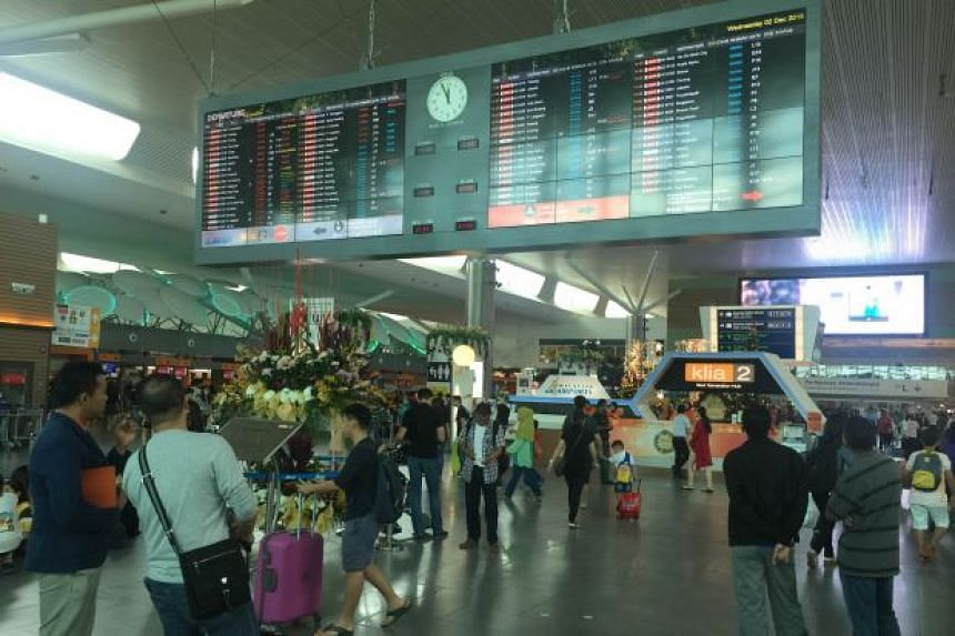 The departure hall at KLIA2 on Wednesday looking busy as usual but flights are back to normal.