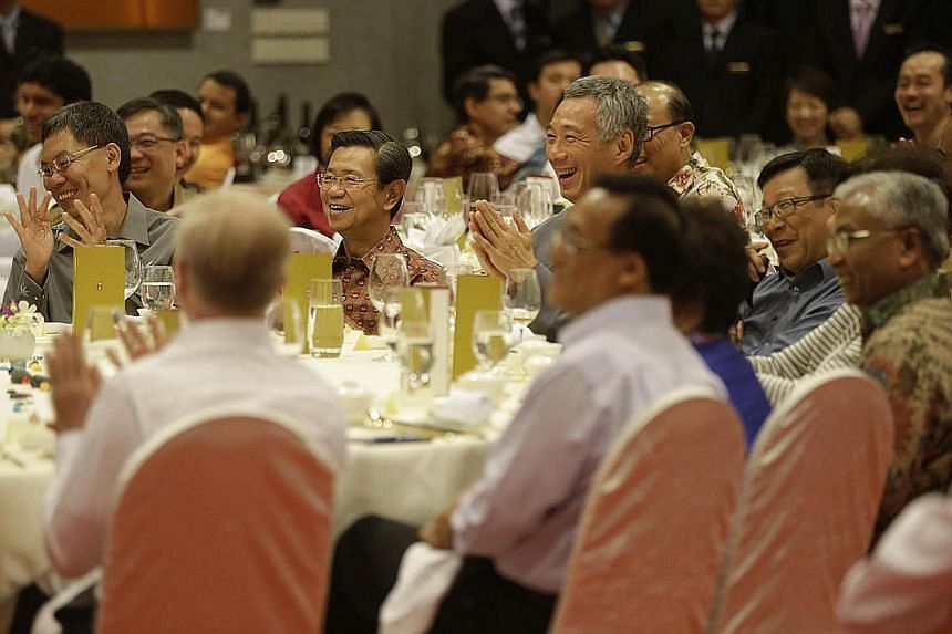 Prime Minister Lee Hsien Loong sharing a light moment during dinner at Parliament House with retired and current MPs, including former officeholders (from left) Mr Lui Tuck Yew, Mr Wong Kan Seng, Mr Mah Bow Tan and Mr Hawazi Daipi. At the dinner, he
