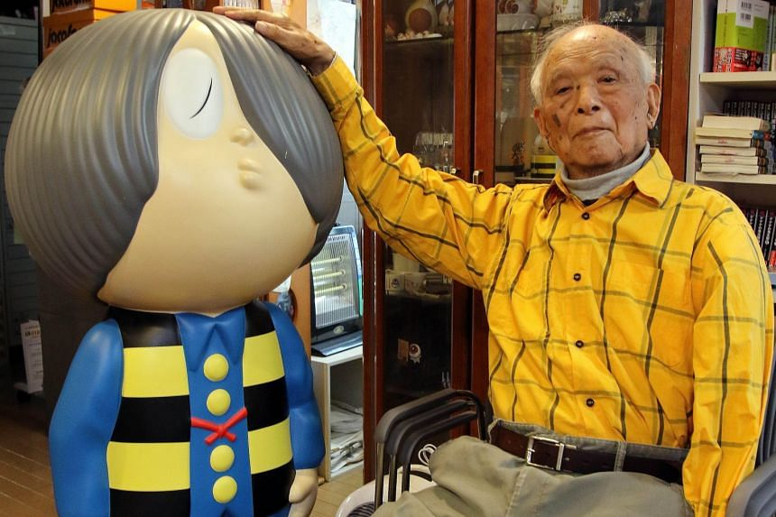 """The late Japanese comic artist Shigeru Mizuki sitting next to his famous character """"Kitaro"""" in his studio in Tokyo earlier this year."""