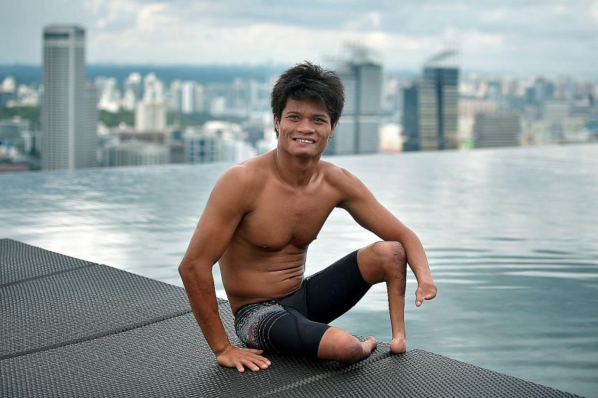 Ernie Gawilan, 24, will compete in three individual and two relay events at the OCBC Aquatic Centre. Sports has offered him another purpose in life and he wants to inspire other people with disabilities.
