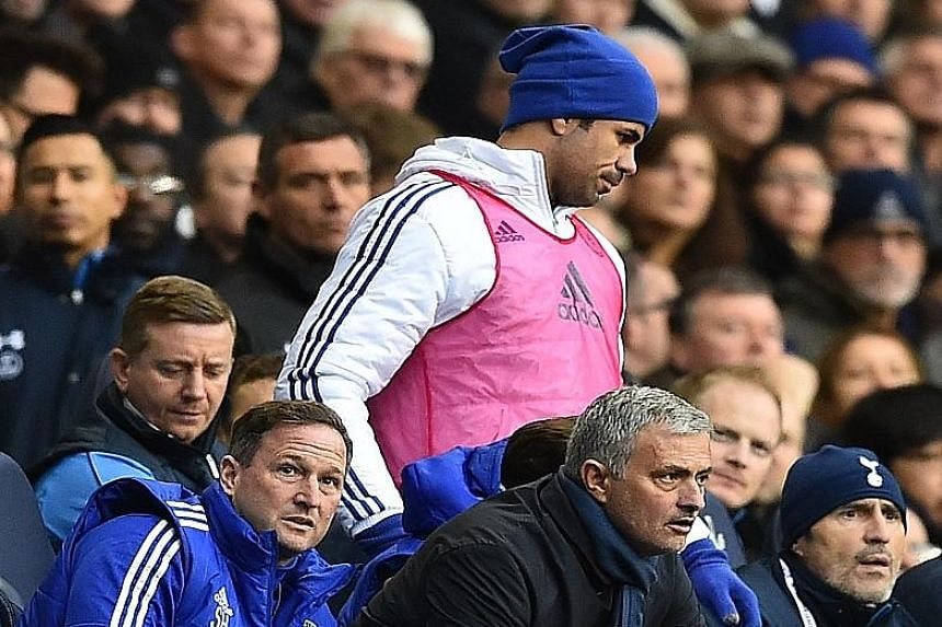 Diego Costa (in pink bib) did not look too pleased when he was axed from the starting XI in Chelsea's match against Tottenham. The striker's form has dipped and he has scored only seven goals for the Blues since January.