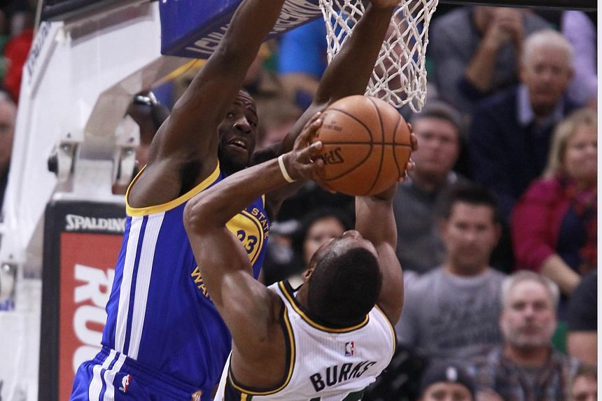 With every NBA team hoping to end the Golden State Warriors' winning streak, forward Draymond Green (left) makes sure he brings his 'A' game to stop the threat from Utah Jazz guard Alec Burks.