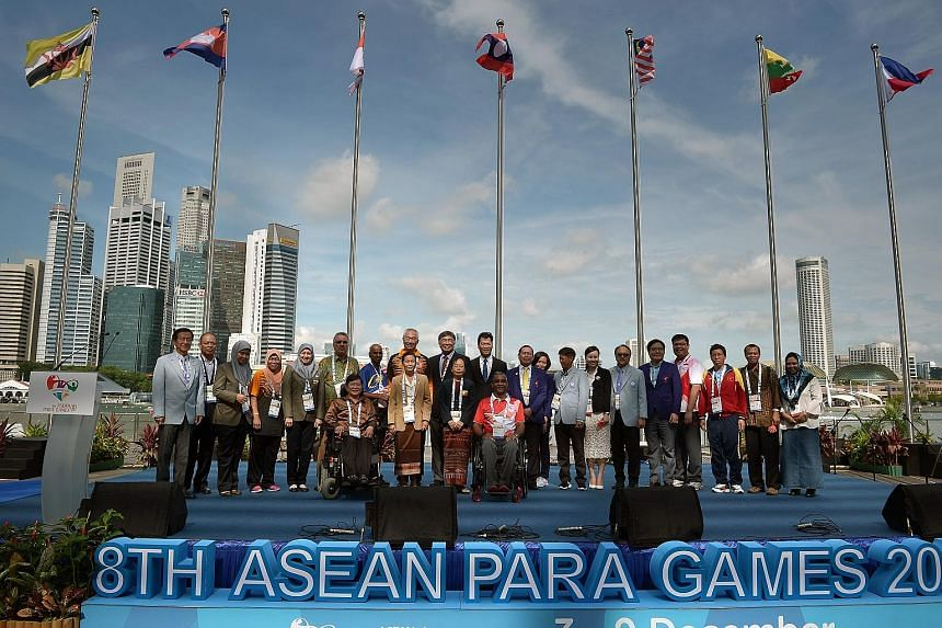 Chefs de mission and delegates from the 10 participating countries posing at the APG welcome ceremony at the Marina Bay Sands events plaza yesterday.
