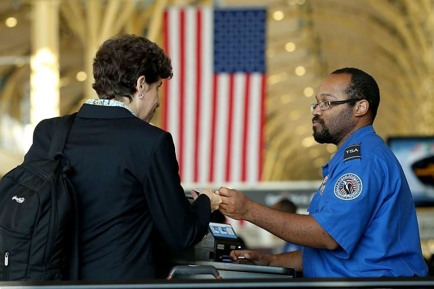 An officer checking a passenger's travel documents at Reagan National Airport in Washington, DC on Nov 25.