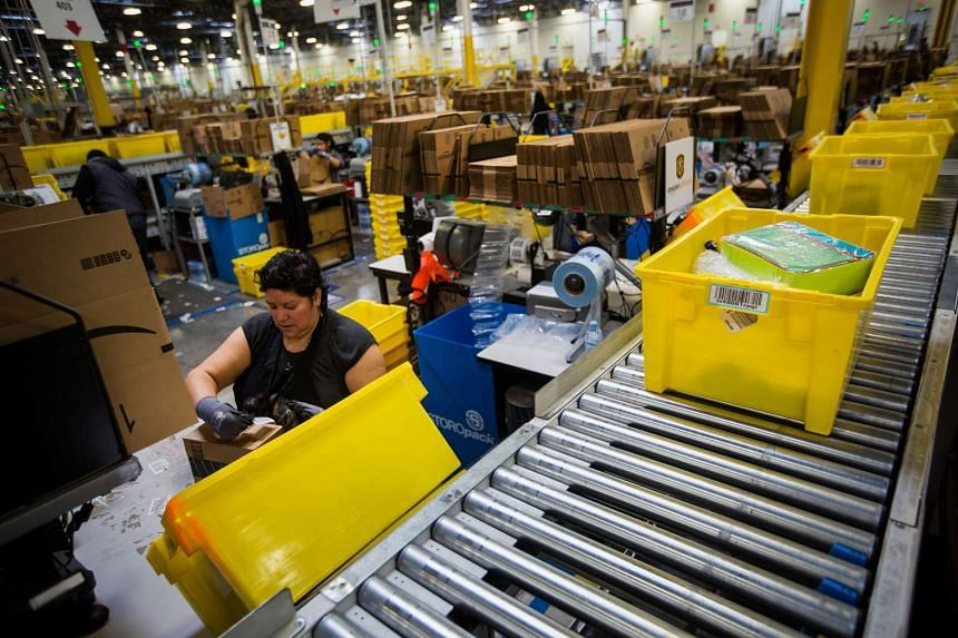 An employee packs a box at the Amazon.com fulfillment centre in Robbinsville, New Jersey.