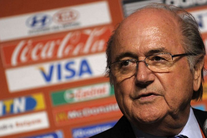 Fifa sponsor logos are seen behind president Sepp Blatter during a 2009 press conference in Cape Town, South Africa.