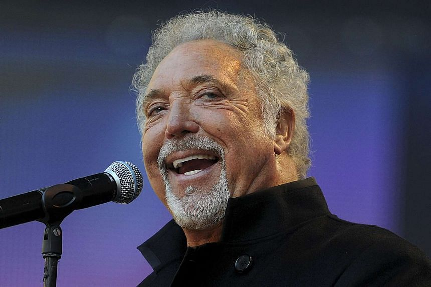 """British singer Tom Jones performs during the """"Help The Heroes Concert 2010"""" in London on Sept 12, 2010."""