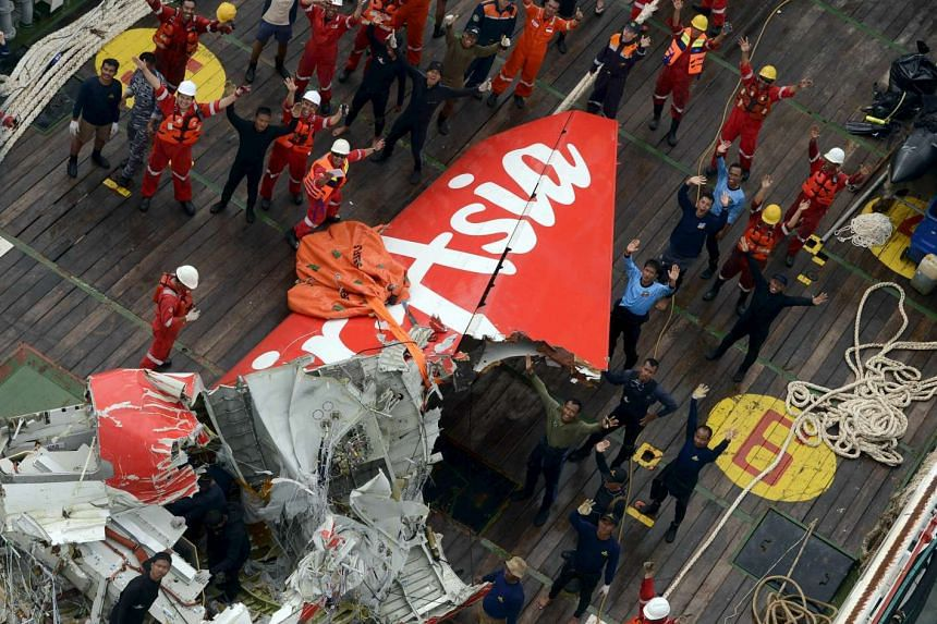 The tail of AirAsia QZ8501 is seen on the deck of a ship after being lifted from the sea bed, south of Pangkalan Bun, on Jan 10, 2015.
