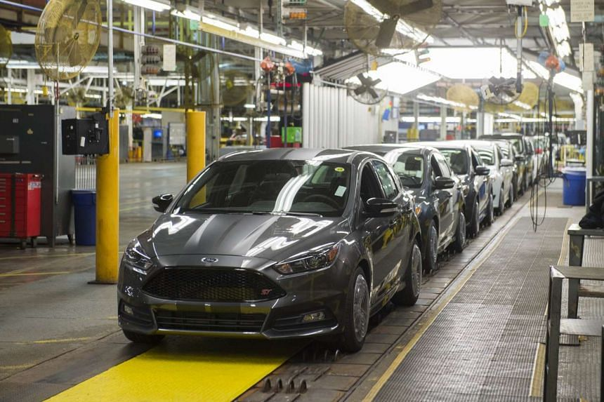 A lineup of Ford Focus vehicles on an assembly line in Wayne, Michigan.