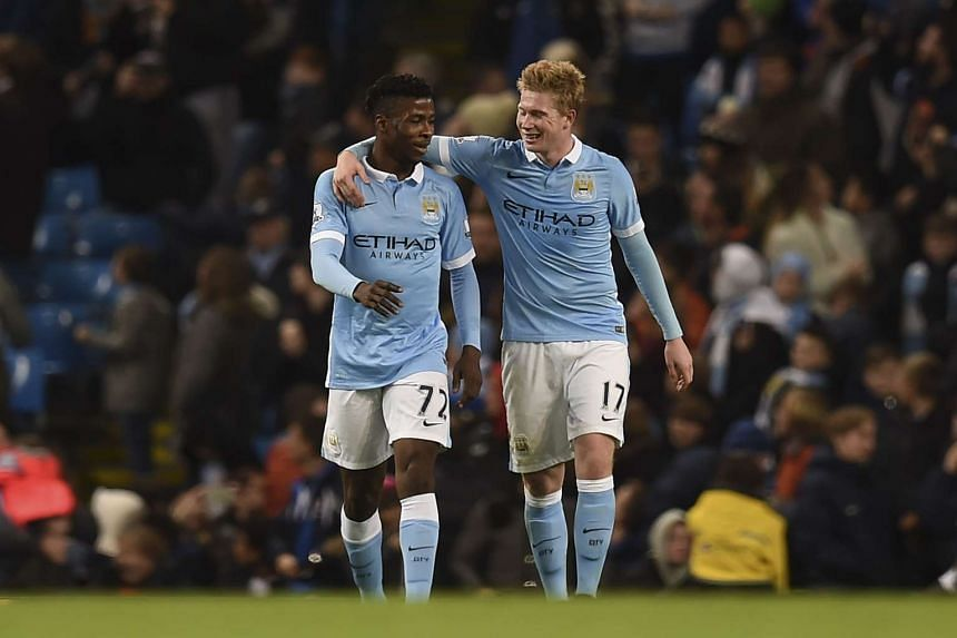 Manchester City's Kevin De Bruyne (right) celebrates with Kelechi Iheanacho after scoring his team's fourth goal.