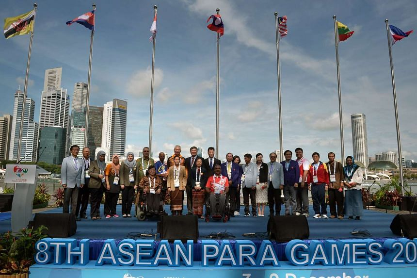 Chef de missions and delegates from 10 participating countries posing for pictures at the welcome ceremony for the Asean Para Games 2015 in Singapore.
