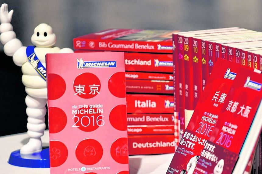 The new Michelin Guide Tokyo 2016 guidebook (left) displayed during the publication's announcement ceremony in Tokyo on Dec 01, 2015.