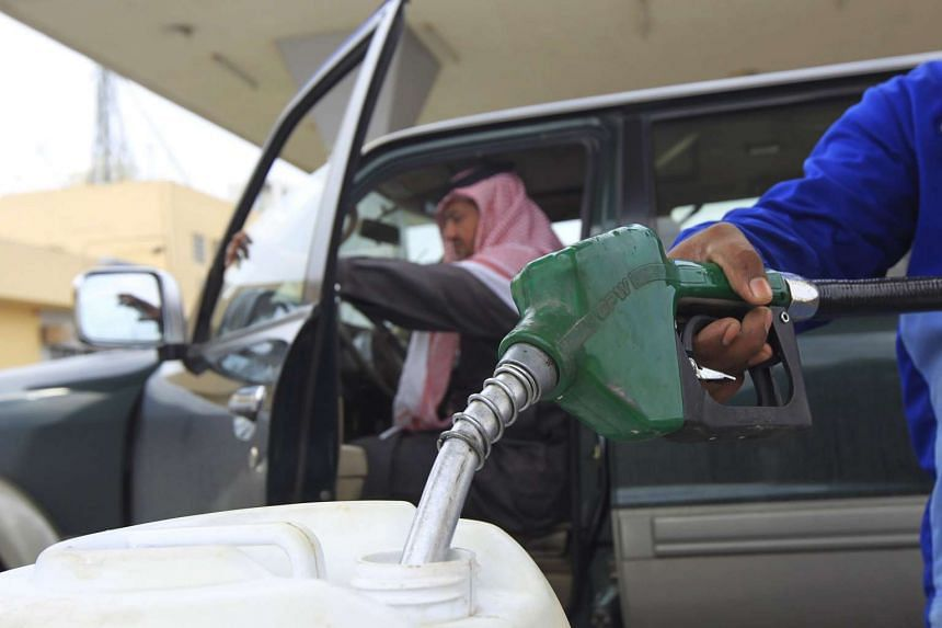 An employee filling a container with diesel at a petrol station in Riyadh in 2012.