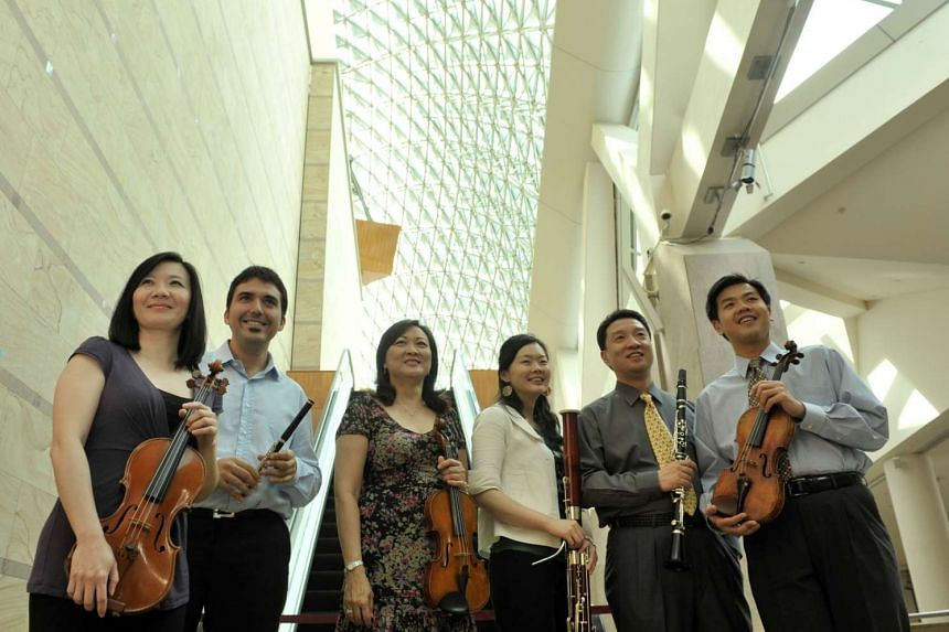 Ma Yue, second from right, is the Singapore Symphony Orchestra's principal clarinettist. He is pictured with fellow musicians in 2009.