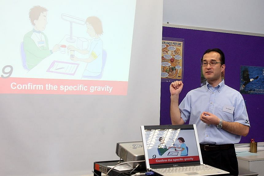 Mr Shin Asakawa conducting a doping course and seminar.