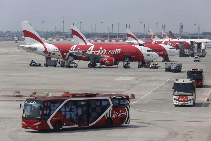 AirAsia airplanes sit on the tarmac at Soekarno-Hatta Airport in Jakarta.