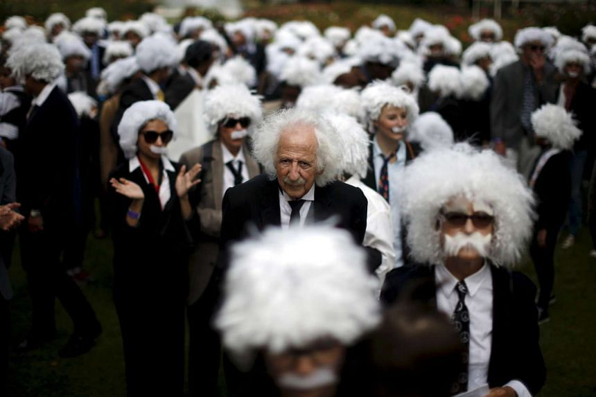 People dressed as Albert Einstein gather to establish a Guiness world record for the largest Einstein gathering.