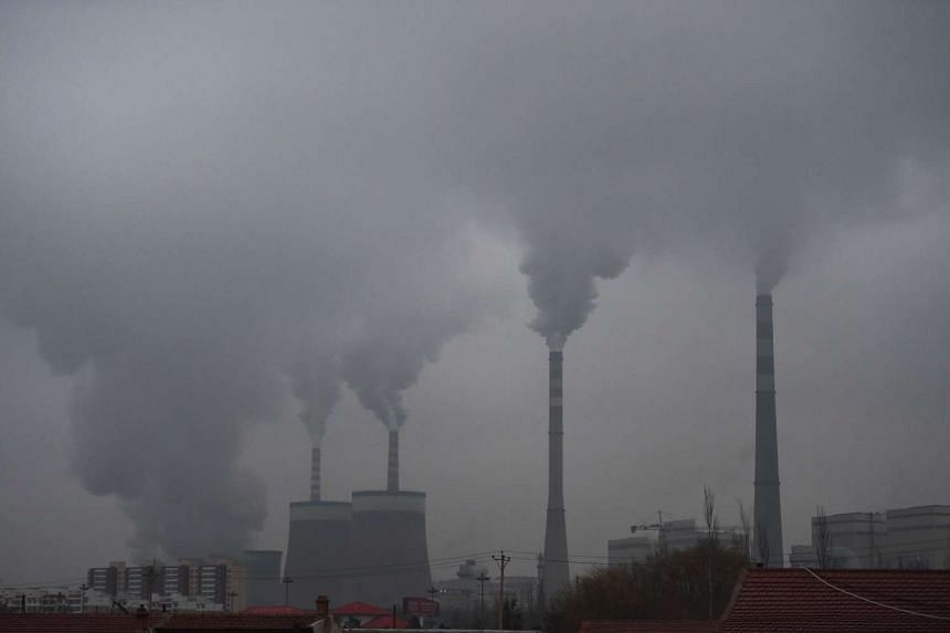 Smoke belches from a coal-fired power station near Datong, in China's northern Shanxi province.