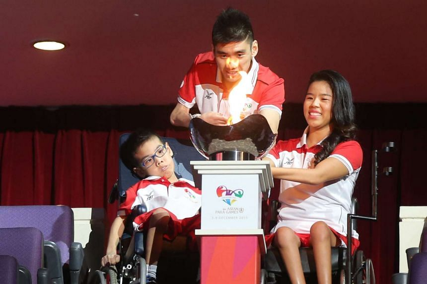 From left) Aloysius Gan, badminton player Tay Wei Ming and swimmer Yip Pin Xiu lighting the cauldron at the Asean Para Games opening ceremony on Dec 3, 2015.
