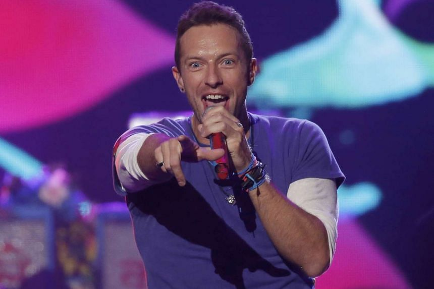 Coldplay's Chris Martin performing at the 2015 American Music Awards.