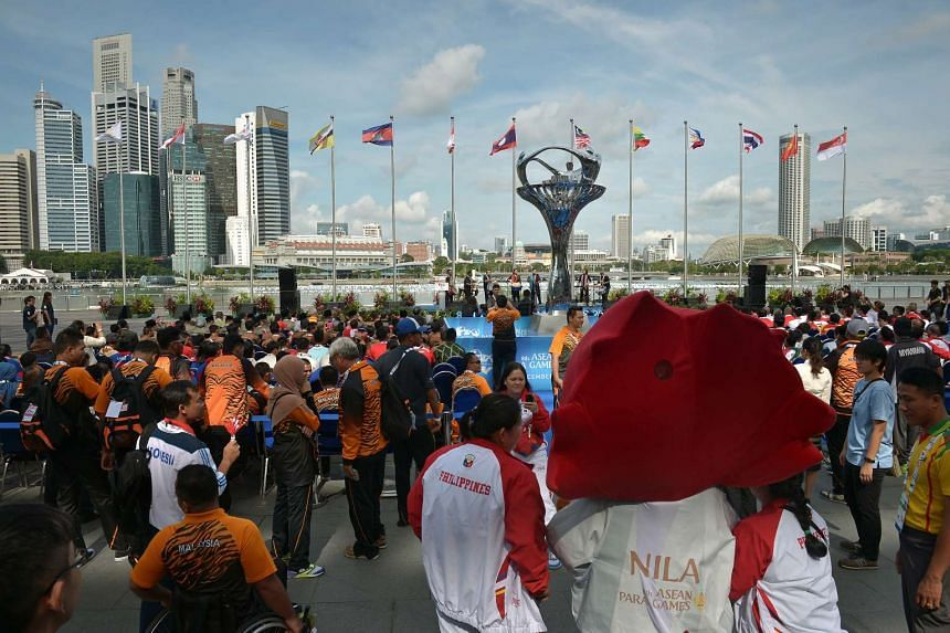 Participants attend the official team welcome ceremony for the Asean Para Games.