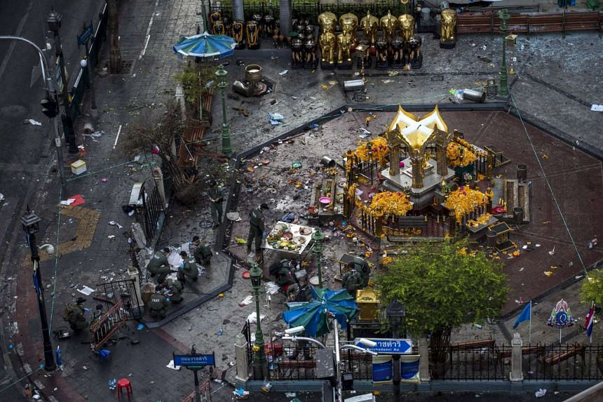 Experts investigate the Erawan shrine at the site of a deadly blast in Bangkok on Aug 18, 2015.