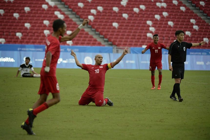 Khairul Anwar Bin Kasmani of Singapore (centre) celebrates after scoring a goal against Indonesia during the Cerebral Palsy opening football match.