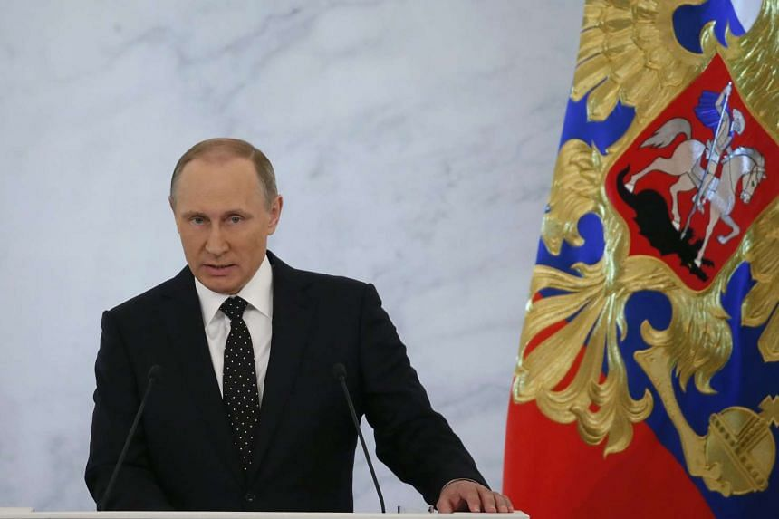 Russian President Vladimir Putin delivers his annual speech at the Grand Kremlin Palace on Dec 3, 2015.